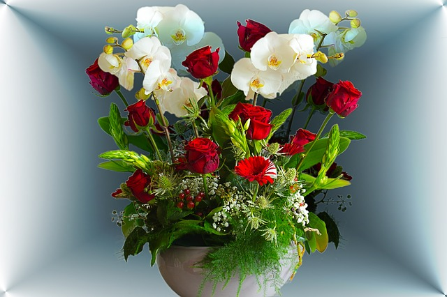 floral arrangement of roses and orchids