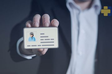How Live Assisted Video KYC Compares with Traditional Identity Verification feature image - man holding up a card